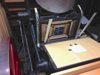 ...placed on this hundred-year-old press and adjusted and tweaked  by Our Dedicated Printer...